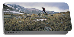 A Man Hikes Towards Mt. Neva 12,814 Ft Portable Battery Charger