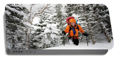 A Man Hiking Through The Snow On Mt Portable Battery Charger