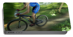 A Mountain Biker Races On A Trail Portable Battery Charger
