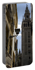 Portable Battery Charger featuring the photograph A Peak At La Giralda by Lorraine Devon Wilke