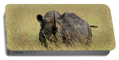 A Rhino Standing In The Grass Portable Battery Charger