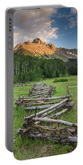 A Scenic Field With Fence And Mountains Portable Battery Charger
