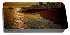 Portable Battery Charger featuring the photograph A September Evening In Brighton by Chris Lord