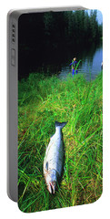 A Silver Coho Salmon Lies On The Grass Portable Battery Charger