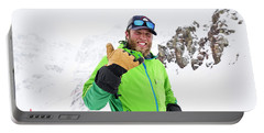 A Skier Smiles During A Sunny Day Portable Battery Charger