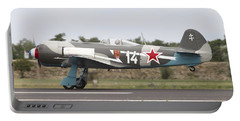 A Soviet Yakovlev Yak-11 Warbird Portable Battery Charger by Timm Ziegenthaler