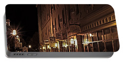 Portable Battery Charger featuring the photograph A Stroll In The City by Deborah Klubertanz