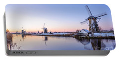 Portable Battery Charger featuring the photograph A Cold Winter Morning With Some Windmills In The Netherlands by IPics Photography
