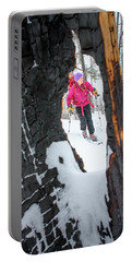 A Woman Backcountry Skier Skins Portable Battery Charger