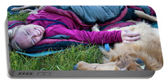 A Woman Curls Up With Her Dogs Portable Battery Charger