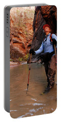 A Woman Hikes Through A River Bed Portable Battery Charger