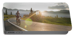 A Woman Road Biking On Highway 550 Portable Battery Charger