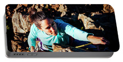 A Woman Rock Climbing In Utahs Uinta Portable Battery Charger