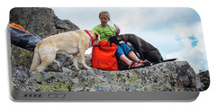 A Woman Sharing Her Lunch With Her K9 Portable Battery Charger