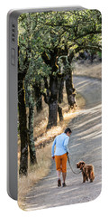 A Woman Takes Her Dog For A Walk Portable Battery Charger