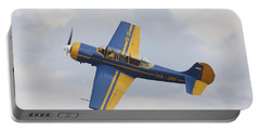A Yakolev Yak-52 Plane Flying Portable Battery Charger by Timm Ziegenthaler