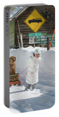 A Young Girl Hauls Her Dog In A Sled Portable Battery Charger