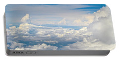 Above The Clouds Over Texas Image B Portable Battery Charger by Byron Varvarigos