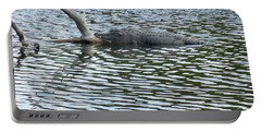 Portable Battery Charger featuring the photograph Alligator Resting On A Log by Ron Davidson