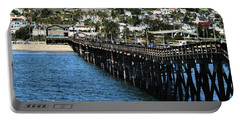 Portable Battery Charger featuring the photograph Along The Pier by Michael Gordon