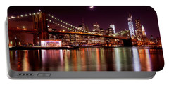 Amazing New York Skyline And Brooklyn Bridge With Moon Rising Portable Battery Charger by Mitchell R Grosky