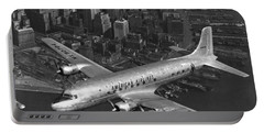 American Dc-6 Flying Over Nyc Portable Battery Charger