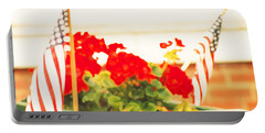 Portable Battery Charger featuring the photograph American Flags And Geraniums In A Wheelbarrow One by Marian Cates