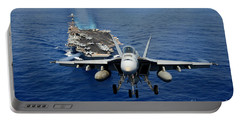 Portable Battery Charger featuring the photograph An Fa-18 Hornet Demonstrates Air Power. by Paul Fearn