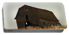 An Old Leaning Barn In North Dakota Portable Battery Charger