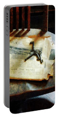 Portable Battery Charger featuring the photograph Antique Keys On Newspaper by Susan Savad