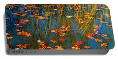 Portable Battery Charger featuring the photograph Autumn  Floating by Peggy Franz