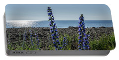 Portable Battery Charger featuring the photograph Backlit Blue Flowers  by Kennerth and Birgitta Kullman