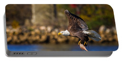 Bald Eagle In Flight Over Water Carrying A Fish Portable Battery Charger