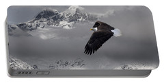 Bald Eagle Soars Above The Snow And Ice Portable Battery Charger