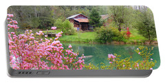 Barn And Flowers Near Pond Portable Battery Charger