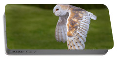 Barn Owl In Flight Portable Battery Charger by Nick  Biemans
