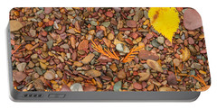 Beach Pebbles Of Montana Portable Battery Charger