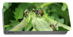 Portable Battery Charger featuring the photograph Beetle Posse by Thomas Woolworth