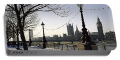 Big Ben Westminster Abbey And Houses Of Parliament In The Snow Portable Battery Charger