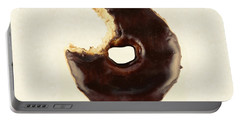 Portable Battery Charger featuring the photograph Chocolate Donut With Missing Bite by Vizual Studio