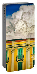 Portable Battery Charger featuring the photograph Big Cloud Over City Building by Silvia Ganora