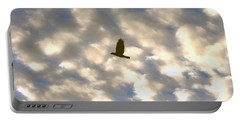 Portable Battery Charger featuring the photograph Bird Across Macerel Clouded Sky by Jay Milo