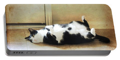 Black And White Cat Reclining Portable Battery Charger by Jayne Wilson