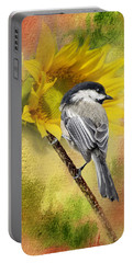 Black Capped Chickadee Checking Out The Sunflowers Portable Battery Charger by Diane Schuster