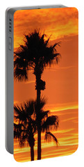 Portable Battery Charger featuring the photograph Blazing Sunset by Deb Halloran
