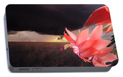 Portable Battery Charger featuring the photograph Blooms Against Tornado by Katie Wing Vigil