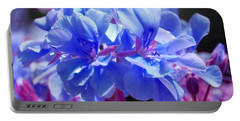 Portable Battery Charger featuring the photograph Blue And Purple Flowers by Matt Harang