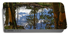 Portable Battery Charger featuring the photograph Blue Sky Reflecting by Jeremy Rhoades