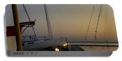 Boats Moored To Pier At Sunset Portable Battery Charger by Charles Beeler