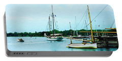 Portable Battery Charger featuring the photograph Boats On A Calm Sea by Susan Savad